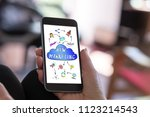 hand holding a smartphone with... | Shutterstock . vector #1123214543