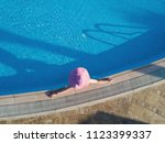 young woman sunbathing in a... | Shutterstock . vector #1123399337