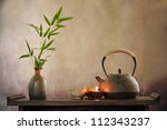 teapot and cup with burning...   Shutterstock . vector #112343237