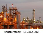 Glow light of petrochemical industry on sunset. - stock photo