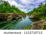 mountain forest river landscape.... | Shutterstock . vector #1123710713