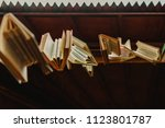 books hung to decorate an... | Shutterstock . vector #1123801787