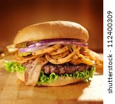 large gourmet hamburger with fried onion straws. - stock photo