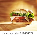 crispy chicken sandwich with bacon and swiss cheese. - stock photo