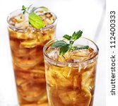 Cold Iced Tea With Mint Garnis...