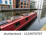 red ship with solar panel... | Shutterstock . vector #1124070707