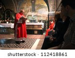 JERUSALEM - OCTOBER 04: Catholic Mass at the 11th Stations of the Cross in the Church of the Holy Sepulchre. Jerusalem on October 04, 2006. - stock photo