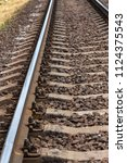 old railroad tracks in... | Shutterstock . vector #1124375543