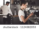 young woman barista preparing... | Shutterstock . vector #1124382053