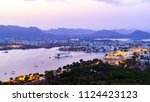 udaipur city at lake pichola in ... | Shutterstock . vector #1124423123