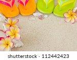 flip flops in the sand with... | Shutterstock . vector #112442423
