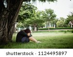 asian woman sitting alone and... | Shutterstock . vector #1124495897