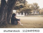 asian woman sitting alone and... | Shutterstock . vector #1124495903
