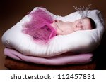 newborn girl in a princess costume. sleeps. - stock photo
