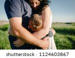 the son hugging parents on... | Shutterstock . vector #1124603867