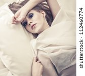 Fashion portrait of a sensual girl in bed - stock photo