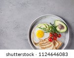 breakfast with fried egg with... | Shutterstock . vector #1124646083