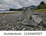 rocky granite coast endocot arm ... | Shutterstock . vector #1124669327