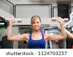 woman working out in a gym | Shutterstock . vector #1124703257
