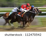 SARATOGA SPRINGS - AUG 31: Jockey Joel Rosario and Tarmarind Hall compete in The Big Bambu Stakes at Saratoga Race Course on Aug 31, 2012 in Saratoga Springs, NY. - stock photo