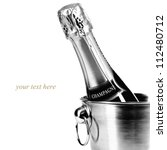 Bottle of champagne in cooler over white (with easy removable sample text) - stock photo