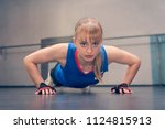 young fitness woman doing push... | Shutterstock . vector #1124815913