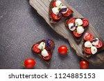 bruschetta with mozzarella and... | Shutterstock . vector #1124885153