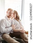 couple is expecting a baby.... | Shutterstock . vector #1124900327