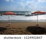 two orange sunshades in front... | Shutterstock . vector #1124902847