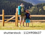 dad and son child with tourist... | Shutterstock . vector #1124908637