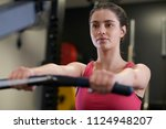woman in gym exercising on... | Shutterstock . vector #1124948207