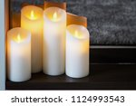 led electric candles stand in... | Shutterstock . vector #1124993543