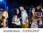 group of friends having great... | Shutterstock . vector #1125012437