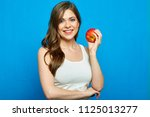 smiling woman holding red apple....   Shutterstock . vector #1125013277
