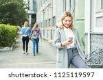 school girl with smartphone.... | Shutterstock . vector #1125119597