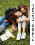 meeting girlfriends in a park.... | Shutterstock . vector #1125119603