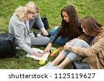 meeting girlfriends in a park.... | Shutterstock . vector #1125119627