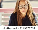closeup portrait of a stylish... | Shutterstock . vector #1125121733
