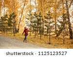 woman with yellow leaves in... | Shutterstock . vector #1125123527