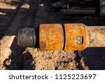 oil drill pipe. rusty drill... | Shutterstock . vector #1125223697