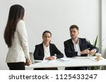 angry executive pointing at... | Shutterstock . vector #1125433247