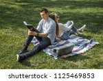 cheerful man and woman resting... | Shutterstock . vector #1125469853