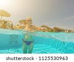 young woman enjoying in the... | Shutterstock . vector #1125530963