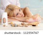 attractive blonde relaxing in... | Shutterstock . vector #112554767