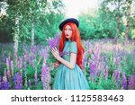 young beautiful redhead girl... | Shutterstock . vector #1125583463