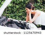 asian woman frustrated and... | Shutterstock . vector #1125670943