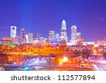 charlotte the queen city skyline in the evening - stock photo