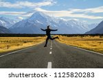 travel new zealand. happy young ... | Shutterstock . vector #1125820283