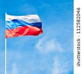 russian national flag against the blue sky - stock photo