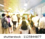 blurred image of people going... | Shutterstock . vector #1125844877